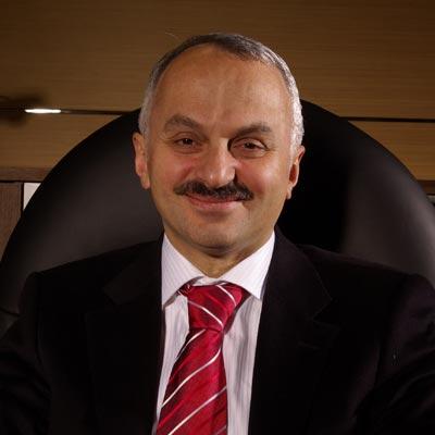 Dr Temel Kotil
